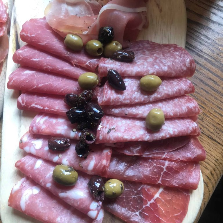 Charcuterie platter with olives